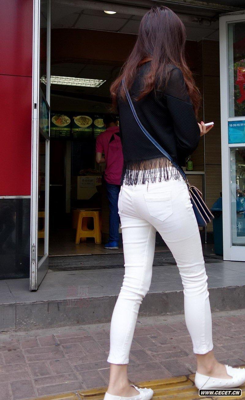 中国娱乐资讯紧身裤女生_公交车站抓拍的黑色紧身裤女生中国娱乐资讯